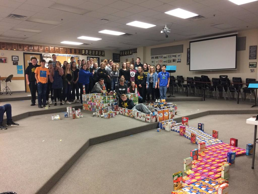 students with canned goods